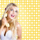 Retro phone beauty with glamour hair and makeup Stock Images