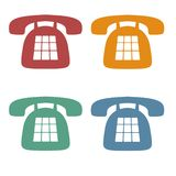 Retro Phone Icons. Red, Orange, Green and Blue Phone Icons, on a white background Stock Images