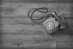 Retro phone isolated on wooden table stock photography
