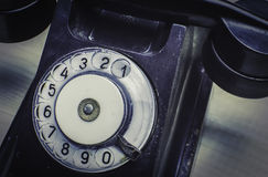 Retro phone on the table Royalty Free Stock Images