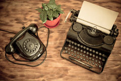 Retro phone and typewriter Stock Photos