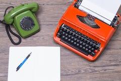Retro phone and typewriter Royalty Free Stock Image