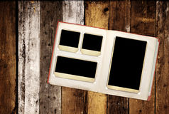 Retro photo album with vintage photo on old wooden boards Stock Photos