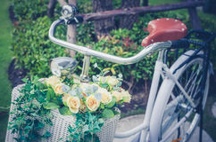 Retro photo of beautiful artificial flowers in bicycle Royalty Free Stock Photography