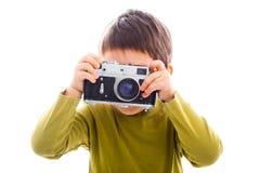 Retro photo camera. Child using a retro photo camera royalty free stock image