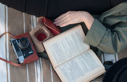 Retro photo camera and a book stock images