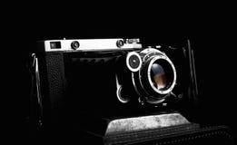 Retro photo camera close up on the black background Stock Photos