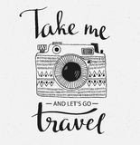 Retro photo camera with grunge background and stylish lettering - Take me and let's go Travel. Royalty Free Stock Photo