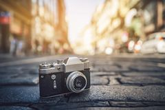 Retro photo camera on the road royalty free stock photography