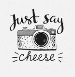 Retro photo camera with stylish lettering - Just say cheese. Vector hand drawn illustration. Stock Images