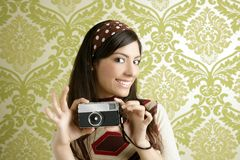 Retro photo camera woman green sixties wallpaper. Retro photo camera shooting woman green sixties wallpaper vintage Stock Image