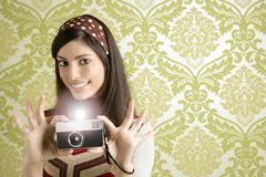 Retro photo camera woman green sixties wallpaper Royalty Free Stock Image