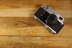 Retro photo camera on wooden background Stock Image