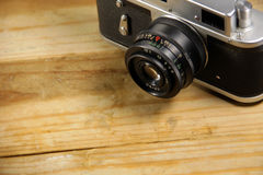Retro photo camera on wooden background Royalty Free Stock Image