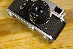 Retro photo camera on a wooden background Stock Photography