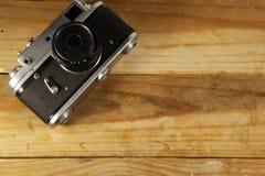 Retro photo camera on wooden background Stock Image