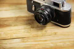 Retro photo camera on wooden background Royalty Free Stock Photography