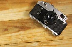 Retro photo camera on wooden background Royalty Free Stock Image