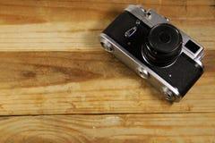 Retro photo camera on wooden background Royalty Free Stock Photo