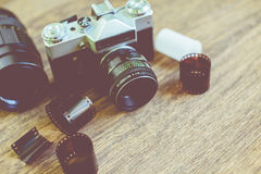 Retro photo camera on a wooden table. Royalty Free Stock Photography