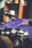 Retro photo camera on a wooden table. Royalty Free Stock Image