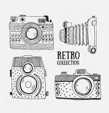 Retro photo cameras set. Vector illustration. Vintage cameras with ornaments. Stock Photos