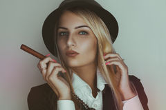Retro photo of cute blonde woman with cigar Stock Photography