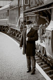 Retro photo of elegant man waiting on platform for train Royalty Free Stock Photo