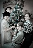 Retro photo of Family near Christmas tree Stock Photo