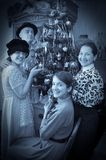 Retro photo of Family near Christmas tree Stock Image