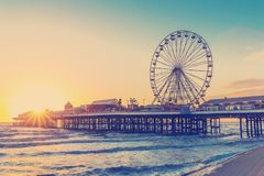 RETRO PHOTO FILTER EFFECT: Blackpool Central Pier at Sunset with Ferris Wheel, Lancashire, England UK.  Royalty Free Stock Photography