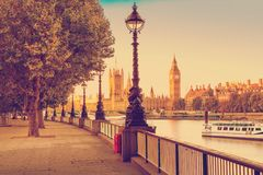 Retro Photo Filter Effect - Street Lamp on South Bank of River Thames with Big Ben and Palace of Westminster in Background, London. England, UK Stock Image