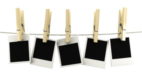 Retro photo frame hanging on a rope on wooden clothespins Stock Photography