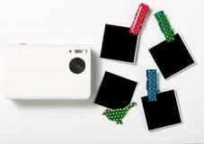 Retro photo frames and camera Stock Images