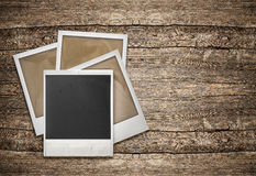 Retro photo frames over wooden background Stock Photo