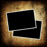 Retro photo frames on wood. Royalty Free Stock Photo