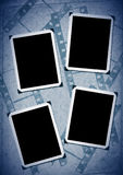 Retro photo framework. Against an old paper with filmstrip Royalty Free Stock Photos