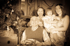 Retro photo of happy family of three generations Royalty Free Stock Image