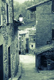 Retro photo of narrow street of old Catalan village Royalty Free Stock Photo