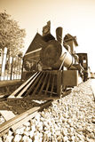 Retro photo of old  locomotive. Retro photo of old steam locomotive at railway station Stock Photo
