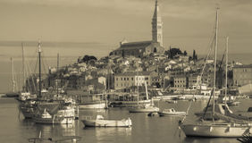 Retro Photo panoramic view of the old town of Rovinj, Croatia. Panoramic view of the old town of Rovinj and boat on the water. Photo like a retro Royalty Free Stock Photos