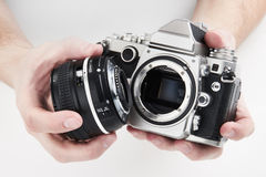 Retro photo SLR camera in hands of photographer closeup Royalty Free Stock Photos