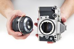 Retro photo SLR camera and lens in hands isolated Royalty Free Stock Image