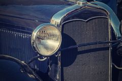 Retro photo of the vintage car closeup Royalty Free Stock Photo