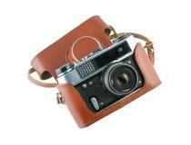 Retro- photocamera in einem ledernen Fall Lizenzfreies Stockbild