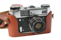 Retro photocamera in a leather case Stock Photography