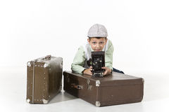 Retro Photograher. A retro style boy is holding old camera isolated on white stock photo