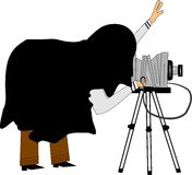 Retro photographer. Photographer from old school with bellows camera and cape over head Royalty Free Stock Photos