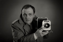 Retro Photographer. Black and white photo of a retro press photographer with an old camera Stock Photo
