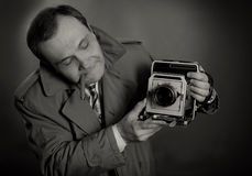 Retro Photographer. Black and white photo of a retro press photographer with an old camera and a sigar Royalty Free Stock Image